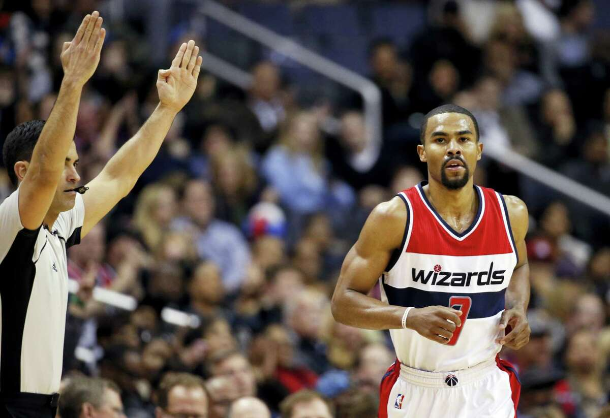 Washington Wizards guard Ramon Sessions (7) jogs back down court after a three-point shot during the second half of an NBA basketball game against the Brooklyn Nets, Wednesday, April 6, 2016, in Washington. Wizards won 121-103. (AP Photo/Alex Brandon)