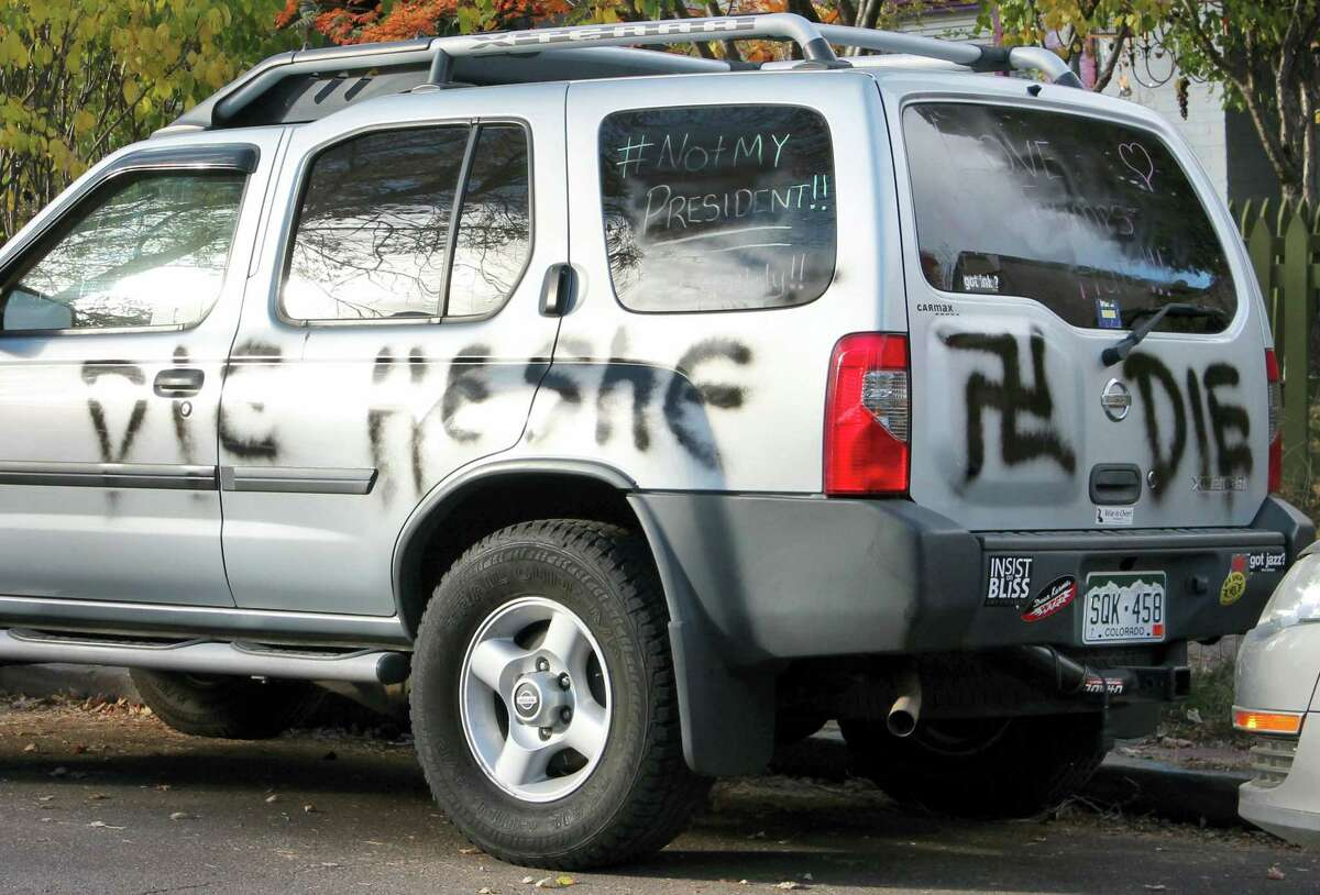 """This Nov. 16, 2016 photo provided by Denverite.com shows spray painted anti-transgender graffiti on the car of Amber Timmons, a transgender woman, in Denver. After the sweeping Republican election victory on Nov. 9, 2016, transgender people """"are concerned for their safety, survival and legal rights in the coming years,"""" said Chase Strangio, an attorney with the American Civil Liberties Union who often works on transgender issues."""