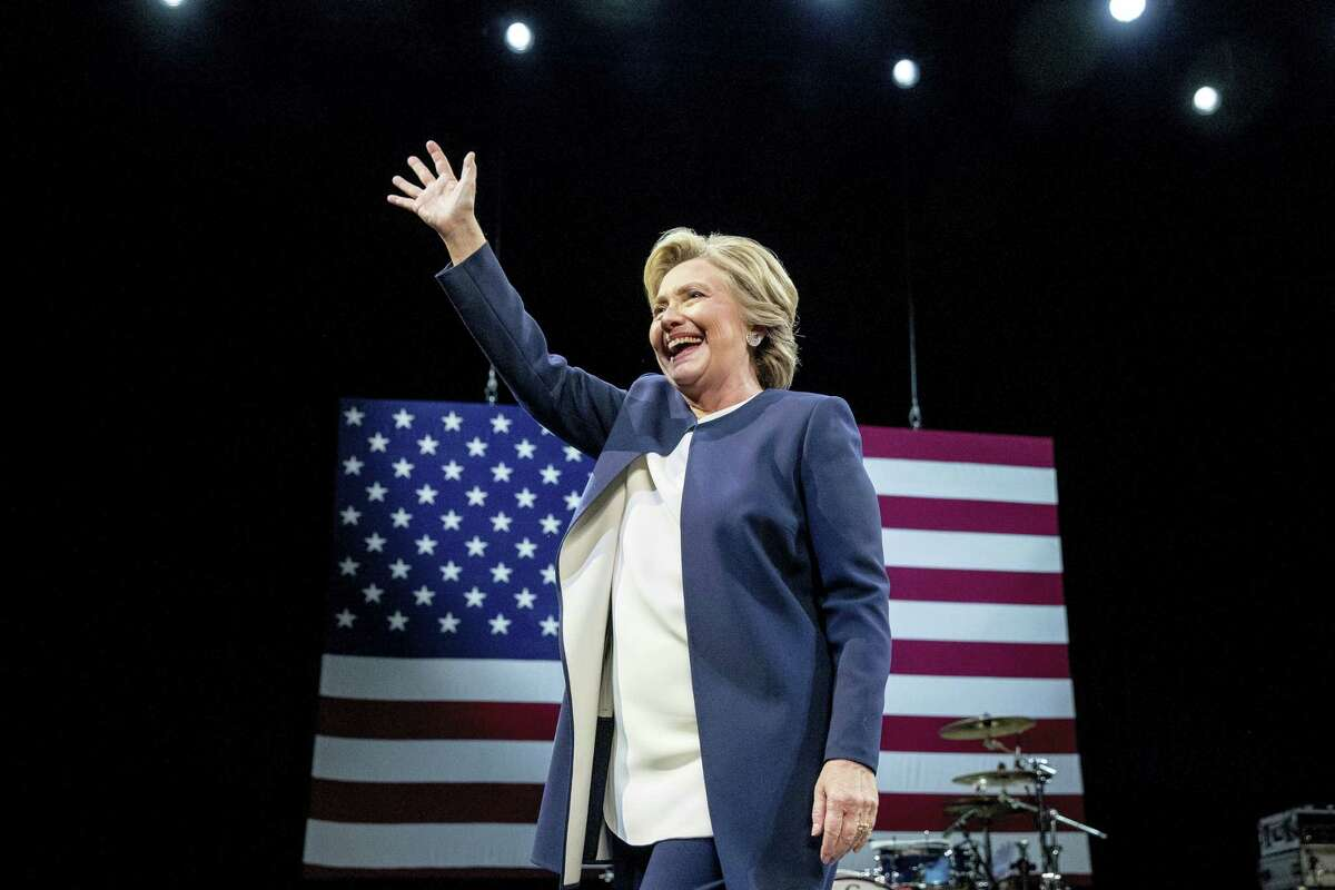 Democratic presidential candidate Hillary Clinton waves after speaking at a fundraiser at the Civic Center Auditorium in San Francisco, Thursday.