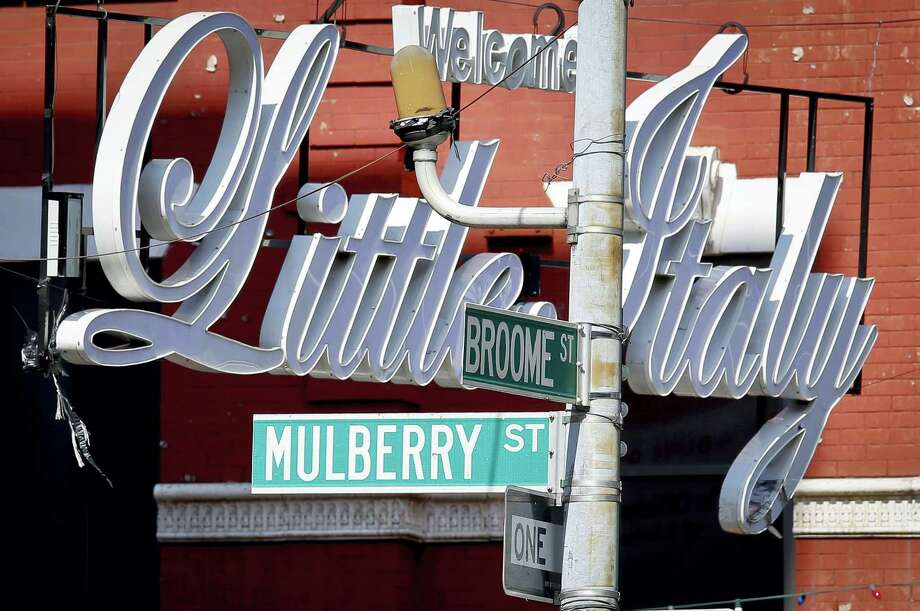 In this Aug. 9, 2016 photo, an overhead sign welcomes visitors to Little Italy at the corner of Broome and Mulberry Streets, in New York. Photo: AP Photo/Bebeto Matthews  / Copyright 2016 The Associated Press. All rights reserved. This material may not be published, broadcast, rewritten or redistribu