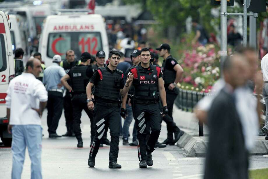 In this Tuesday, June 7, 2016, file photo, Turkish police and ambulances gather at an explosion site after a bus carrying riot police was struck by a bomb in Istanbul. Well before police could establish who was responsible for the car bombing, the government had banned the media from reporting anything about the investigation. Bans have been implemented after such incidents since 2013 and have become so routine that some joke on Twitter that the ban arrives before the ambulance — but they're part of what free-speech advocates say is an increasingly concerning pattern of restricting news coverage in Turkey. Photo: AP Photo/Lefteris Pitarakis, File   / Copyright 2016 The Associated Press. All rights reserved. This material may not be published, broadcast, rewritten or redistribu
