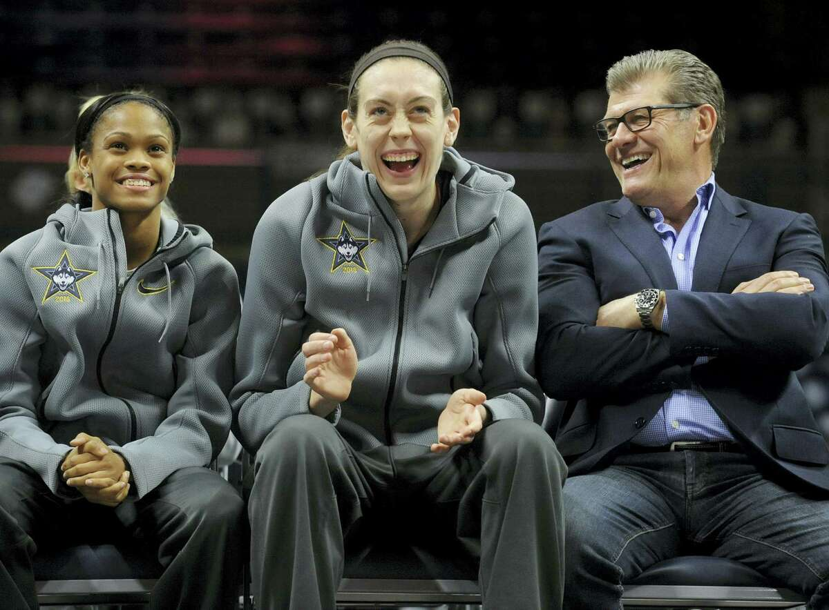 UConn's Breanna Stewart, center, shares a laugh with UConn coach Geno Auriemma, and Moriah Jefferson, left, during a rally inside Gampel Pavilion on Wednesday.