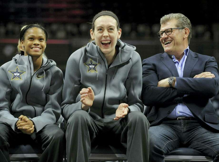 UConn's Breanna Stewart, center, shares a laugh with UConn coach Geno Auriemma, and Moriah Jefferson, left, during a rally inside Gampel Pavilion on Wednesday. Photo: Jim Michaud — Journal Inquirer Via AP  / Journal Inquirer