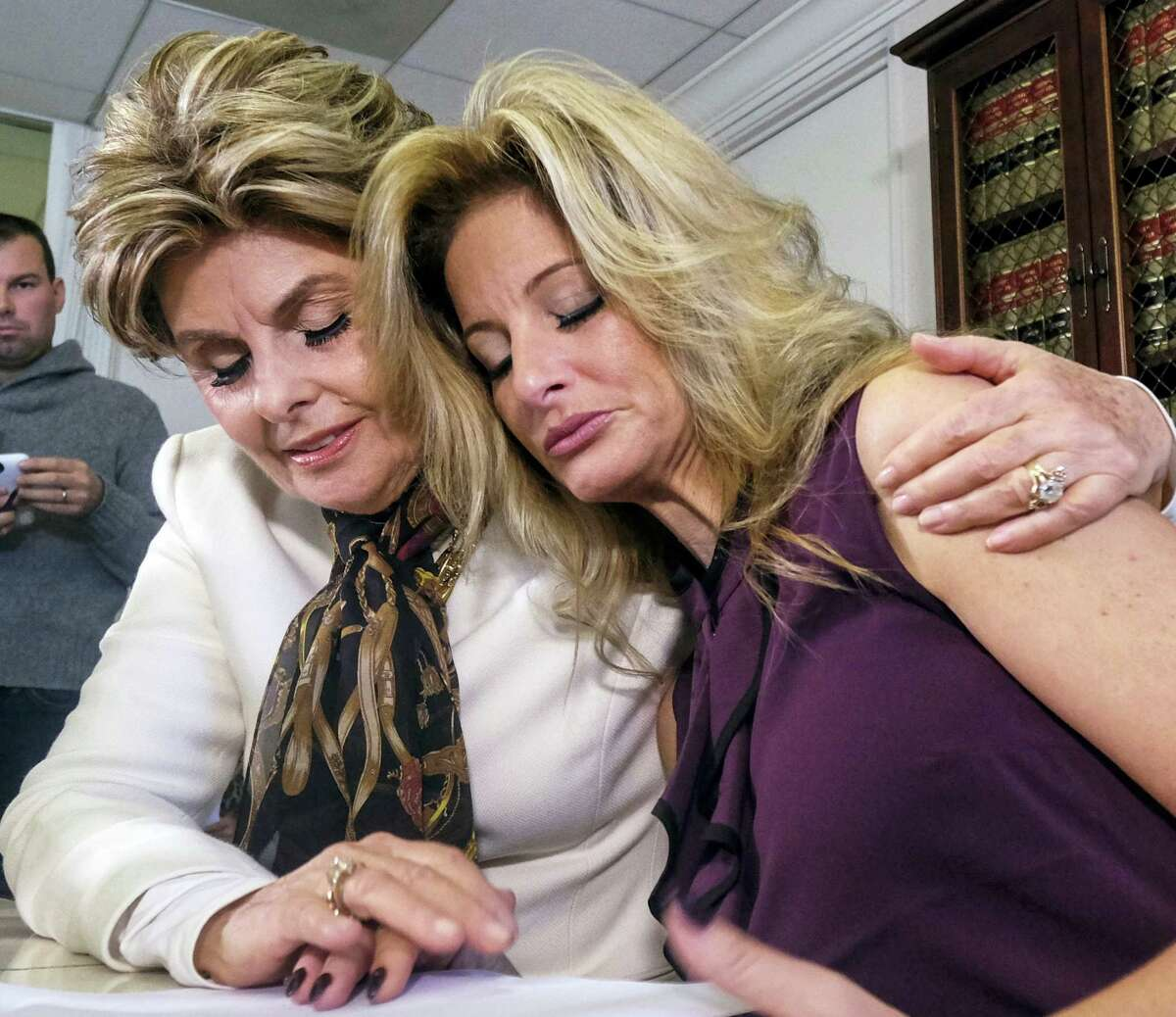 "Attorney Gloria Allred, left, comforts Summer Zervos during a news conference in Los Angeles, Friday. Zervos, a former contestant on ""The Apprentice"" says Republican presidential candidate Donald Trump made unwanted sexual contact with her at a Beverly Hills hotel in 2007. Zervos is among several women who have made sexual allegations against the Republican nominee. He has strenuously denied them."