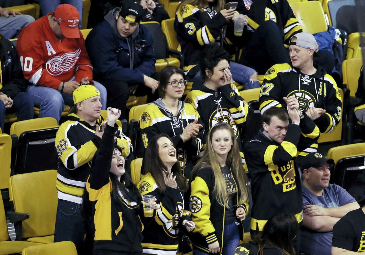 Bruins fans cheer late in the third period on Thursday.