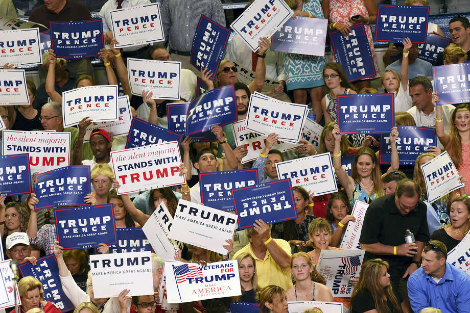 Republican presidential candidate Donald Trump supporters attend a rally for Trump in Wilmington, North Carolina, Tuesday. Photo: Ken Blevins — The Star-News Via AP   / The Star-News