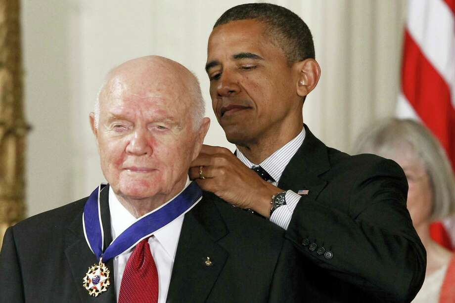 In this May 29, 2012, file photo, President Barack Obama awards the Medal of Freedom to former astronaut John Glenn during a ceremony in the East Room of the White House in Washington. Glenn, the first American to orbit Earth who later spent 24 years representing Ohio in the Senate, died Thursday. Photo: The Associated Press  / AP2012