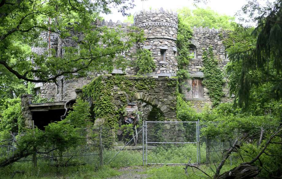 Hearthstone Castle is overgrown with foliage in Danbury. The city is planning to demolish the castle, a landmark listed on the National Register of Historic Places, that was built in 1899 and has fallen into disrepair. Photo: Tyler Sizemore — Hearst Connecticut Media Via AP / The News-Times