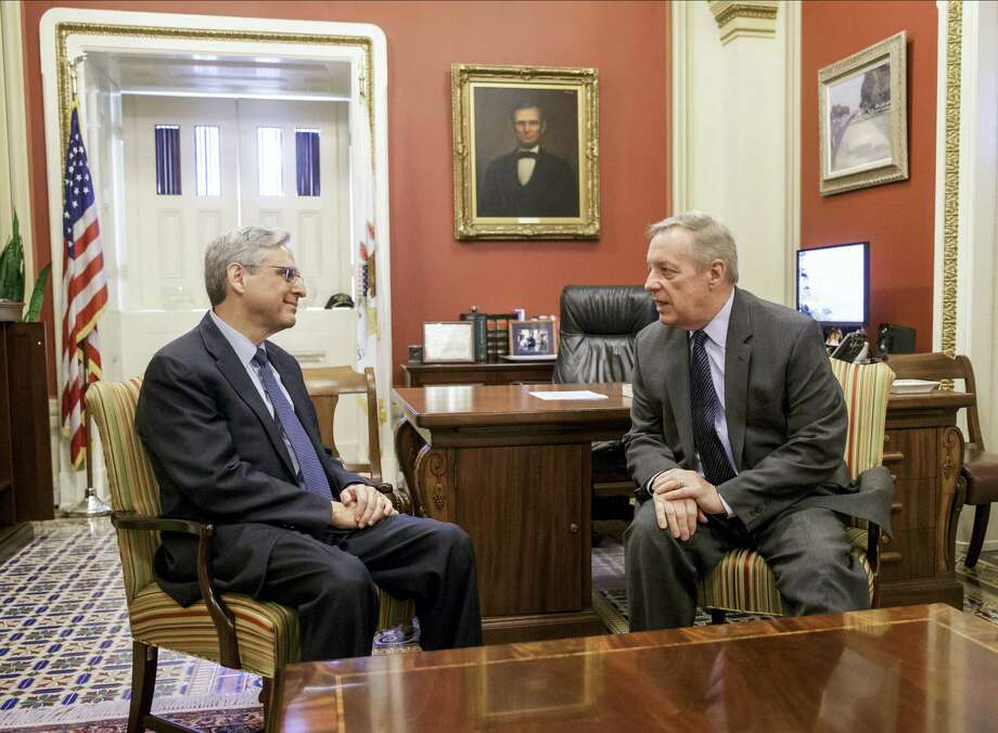 Judge Merrick Garland, President Barack Obama's choice to replace the late Justice Antonin Scalia on the Supreme Court, meets with Senate Minority Whip Richard Durbin of Ill., a member of the Senate Judiciary Committee which considers nominations to the high court, Wednesday, April 6, 2016, on Capitol Hill in Washington. Photo: AP Photo/J. Scott Applewhite   / AP