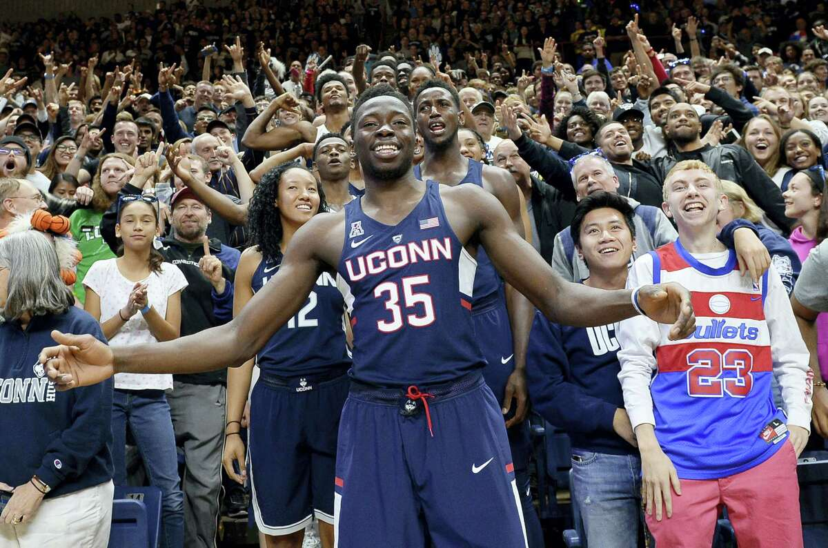 UConn's Amida Brimah (35) stands with fans and players during Friday's First Night event in Storrs.