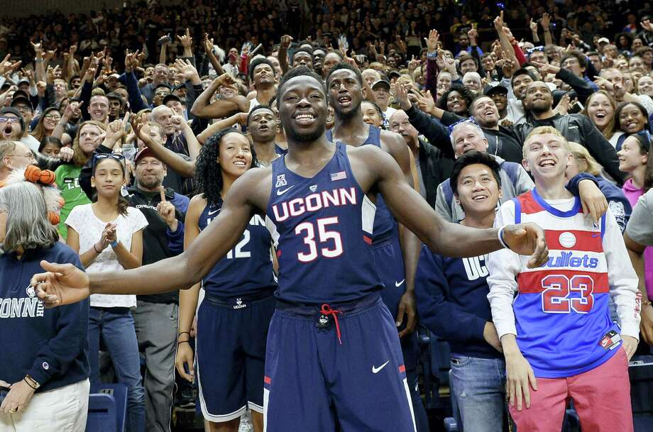 UConn's Amida Brimah (35) stands with fans and players during Friday's First Night event in Storrs. Photo: Jessica Hill — The Associated Press  / AP2016