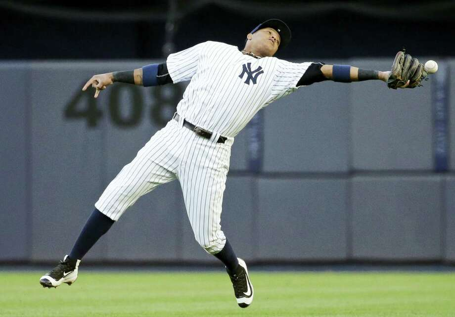 New York Yankees second baseman Starlin Castro loses control of the ball hit by Los Angeles Angels' C.J. Cron for an error during the second inning Thursday. The Yankees won 6-3 to sweep the four-game series. Photo: FRANK FRANKLIN II — THE ASSOCIATED PRESS  / Copyright 2016 The Associated Press. All rights reserved. This material may not be published, broadcast, rewritten or redistribu