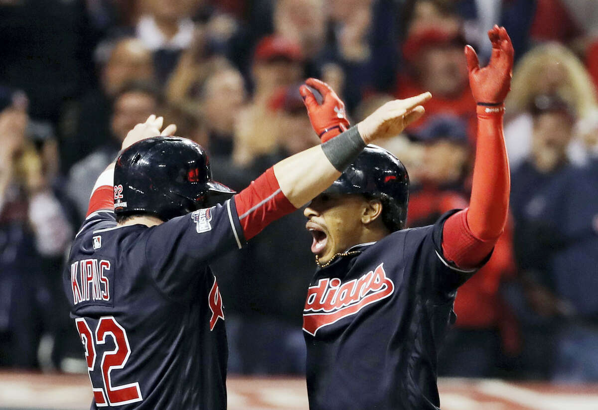Francisco Lindor, right, celebrates after his two-run home run in the sixth inning on Friday.