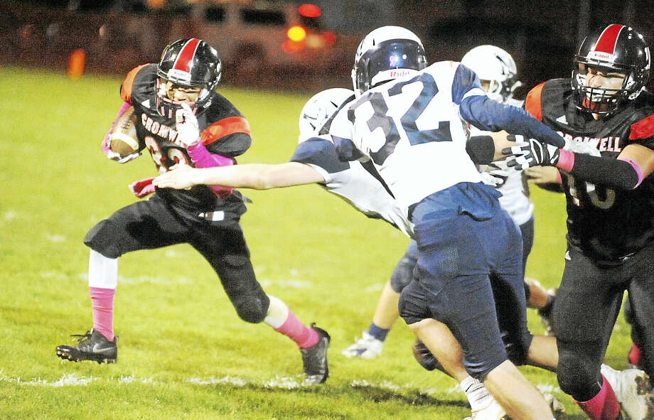 Cromwell/Portland senior Kristian Sapp tries to turn the corner in the Panthers' 37-7 win over Morgan on Friday night. Photo: Jimmy Zanor - The Middletown Press
