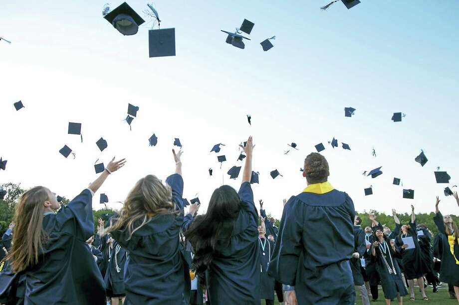 Mortarboards seemed to take flight into the night air Wednesday as newly minted graduates expressed their joy at completing their four years at Middletown High. Photo: Sandy Aldieri — Special To The Press