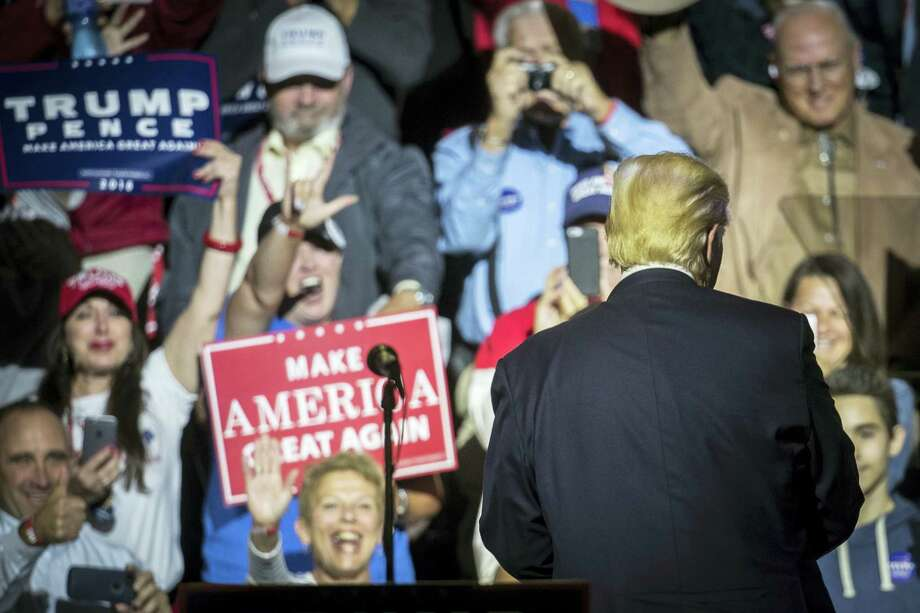 Republican presidential candidate Donald Trump, right, turns from the podium after speaking during a campaign rally, Thursday in Cincinnati. Photo: John Minchillo — The Associated Press  / AP
