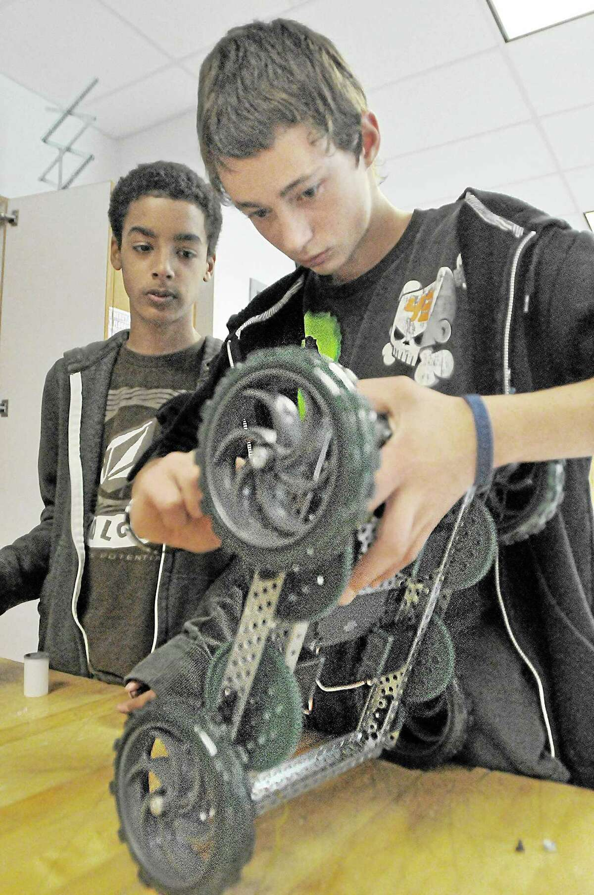 Students work on a robot frame in Sam Faulkenberry's robotics class at Middletown High School in this 2013 photograph.