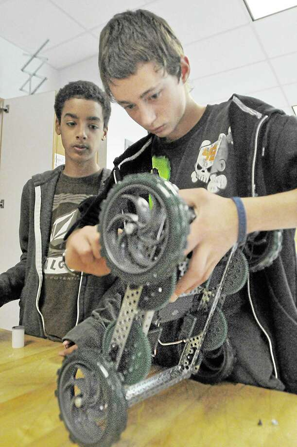 Students work on a robot frame in Sam Faulkenberry's robotics class at Middletown High School in this 2013 photograph. Photo: File Photo  / TheMiddletownPress