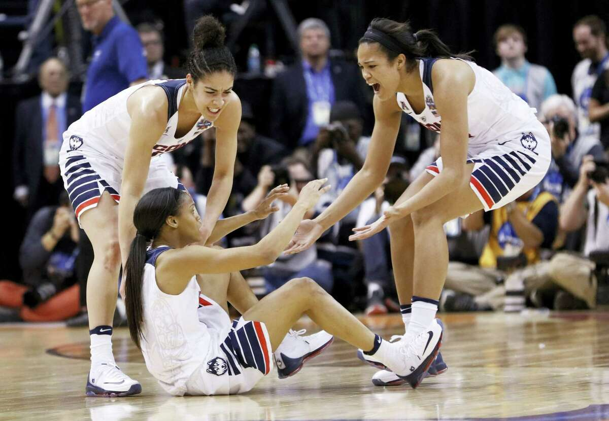 Connecticut's Moriah Jefferson, center, is congratulated by teammates Kia Nurse, left, and Napheesa Collier, right, after Jefferson hit a shot at the end of the first quarter of the championship game against Syracuse, at the women's Final Four in the NCAA college basketball tournament Tuesday, April 5, 2016, in Indianapolis. (AP Photo/AJ Mast)