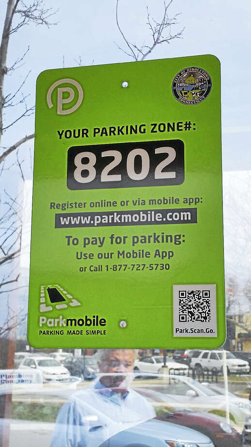 Paying to park in downtown Middletown, such as at the Melilli lot, can be made at the kiosk or from anywhere by tapping the Parkmobile app on a smartphone. Photo: Kathleen Schassler — The Middletown Press