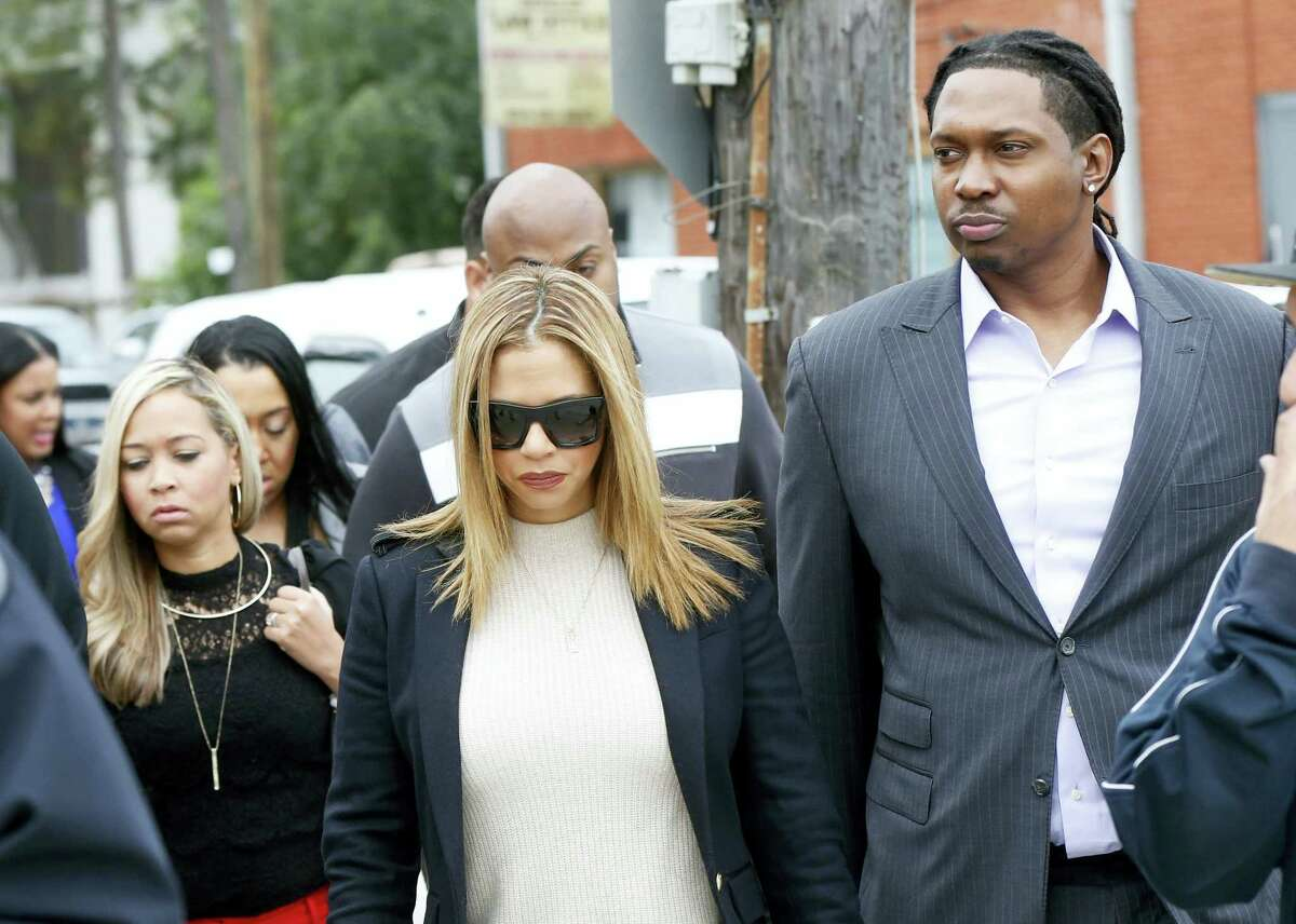 Racquel Smith, widow of former NFL New Orleans Saints football player Will Smith, arrives with family and friends at Orleans Parish Criminal District Court, for the trial of Cardell Hayes in New Orleans, Wednesday, Dec. 7, 2016. Hayes shot Will Smith to death in a road rage incident, in which Racquel Smith was struck in the legs by the gunfire.