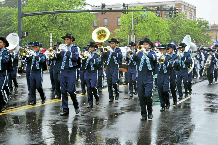 Cassandra Day - The Middletown Press Families flocked to the city's patriotic Memorial Day parade on Monday, which began with a light drizzle and as the color guard, police and fire units, state and local dignitaries, the Keigwin, Woodrow Wilson and Middletown High School bands, little dancers and floats moved along Main Street, the rain generously receded. Photo: Cassandra Day — The Middletown Press