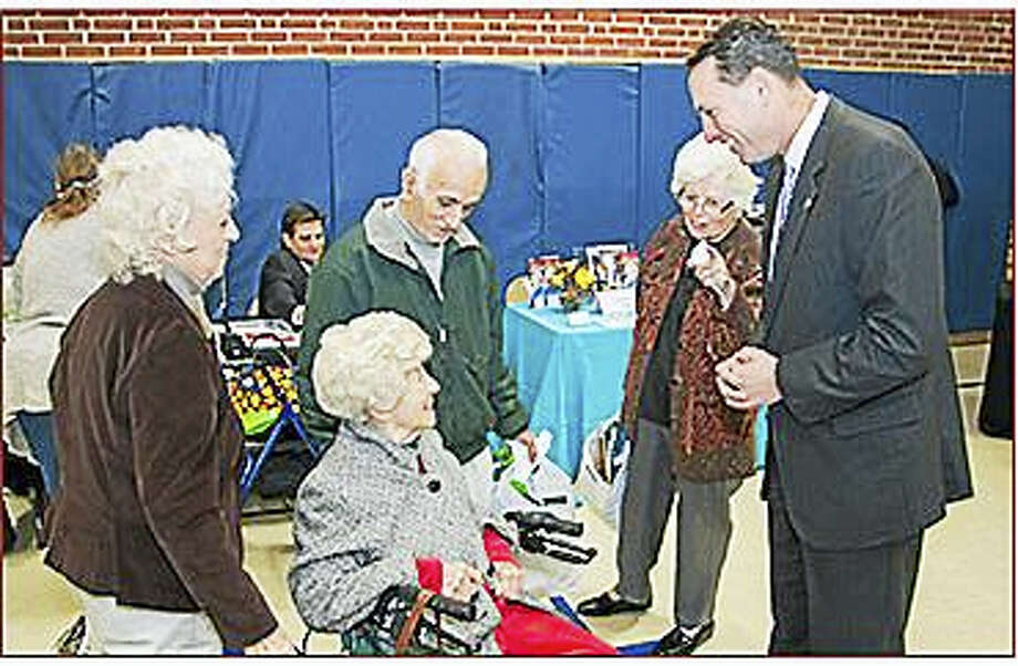 State Sen. Paul Doyle, right, greets residents who took part in the annual senior expo at the Cromwell Senior Center in November. Photo: Photo Courtesy Senate Democrats