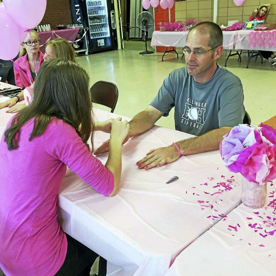 East Hampton High Athletic Director and coach Shaun Russell had no qualms last year when getting his nails painted with pink polish. Photo: Contributed Photo