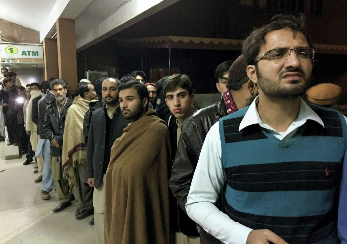 People gather outside the emergency ward, where authorities brought the bodies of plane crash victims, at a hospital, in Abbottabad, Pakistan, Wednesday, Dec. 7, 2016. Pakistan's national carrier says one of its planes has crashed shortly after takeoff from the northern city of Chitral with 48 people aboard. A spokesman for Pakistan's Civil Aviation Authority said Wednesday that the cause of the crash was unclear and there was believed to be little chance of finding survivors.