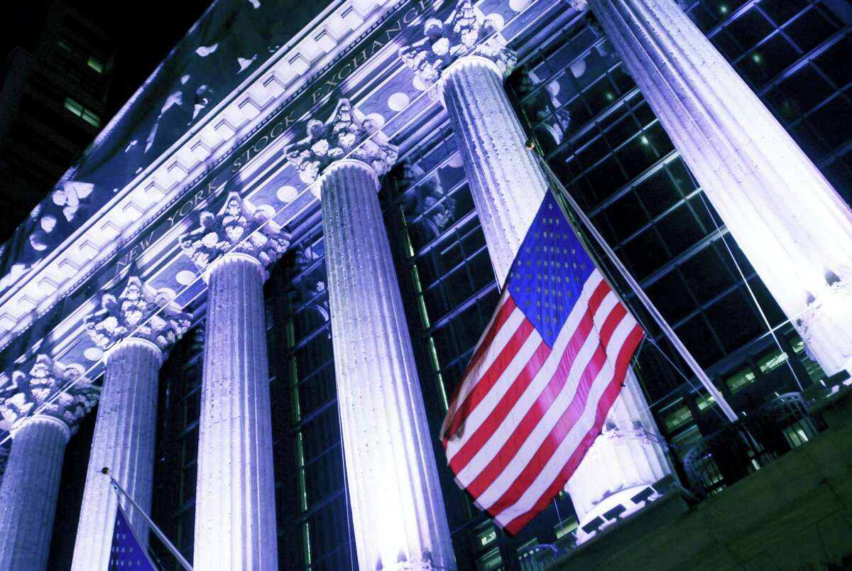 An American flag flies in front of the New York Stock Exchange.