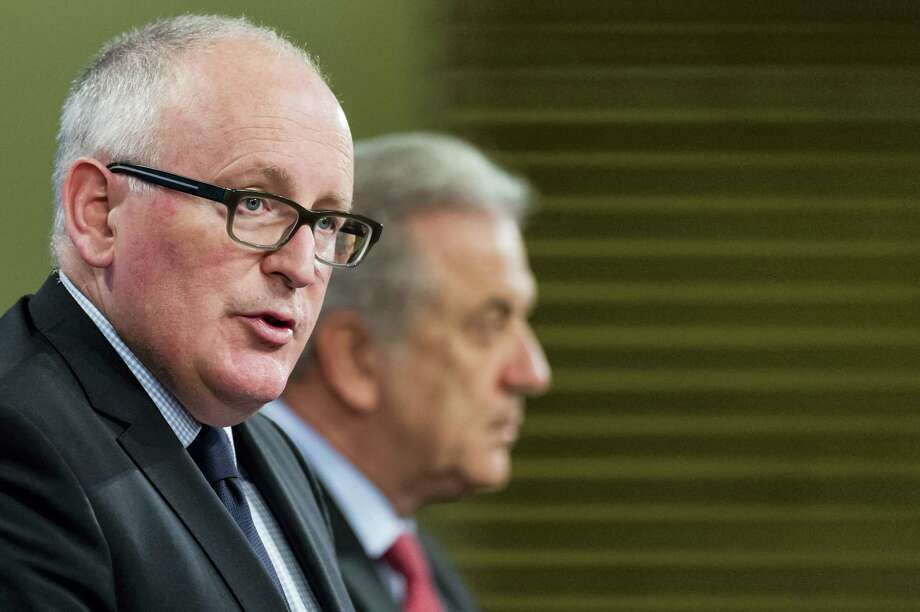EU Commission First Vice President Frans Timmermans, left, and EU Commissioner for Migration, Home Affairs and Citizenship Dimitris Avramopoulos address the media on migration at EU Commission headquarters in Brussels on April 6, 2016. After a migrant crisis that has shaken the European Union, the EU's executive wants a fundamental reform of policies that have heaped pressure on some nations like Greece and Italy. Photo: AP Photo/Geert Vanden Wijngaert  / AP