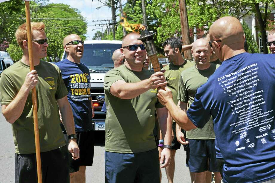 Thursday was the third leg of the Special Olympics Connecticut Law Enforcement Torch Run as runners made their wary from Branford to Hartford, passing through Middletown at 1 p.m. Photo: Cassandra Day — The Middletown Press