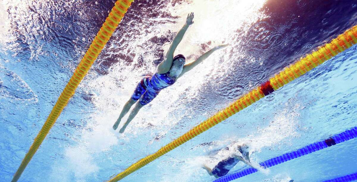 United States' Dana Vollmer competes in a semifinal of the women's 100-meter butterfly during the swimming competitions at the 2016 Summer Olympics on Aug. 6, 2016 in Rio de Janeiro, Brazil.