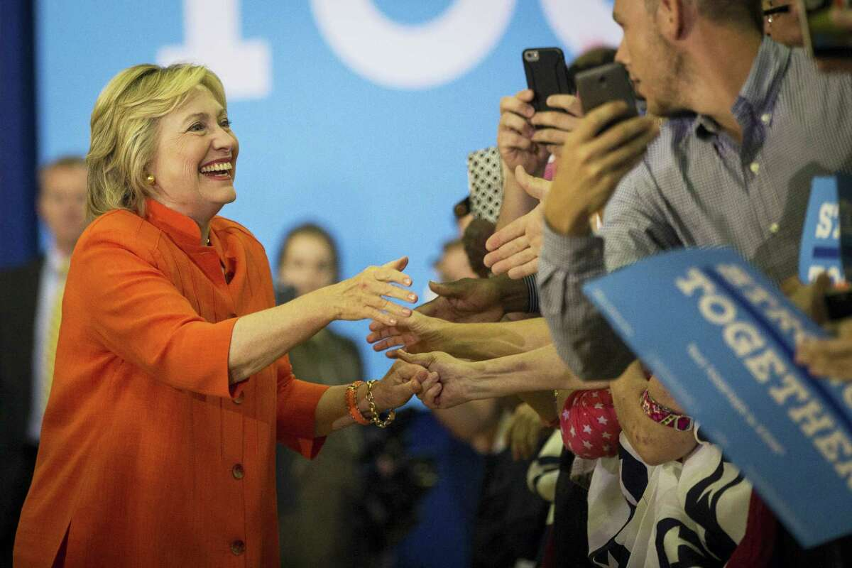 Democratic presidential candidate Hillary Clinton greets supporters before taking the stage for a campaign rally at The Coliseum in St. Petersburg, Fla., on Aug. 8, 2016.