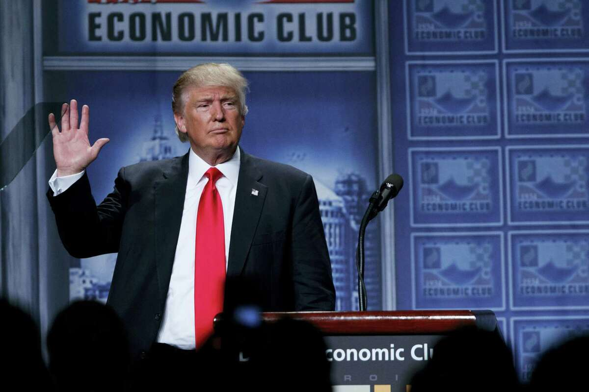 Republican presidential candidate Donald Trump waves after delivering an economic policy speech to the Detroit Economic Club on Aug. 8, 2016 in Detroit.