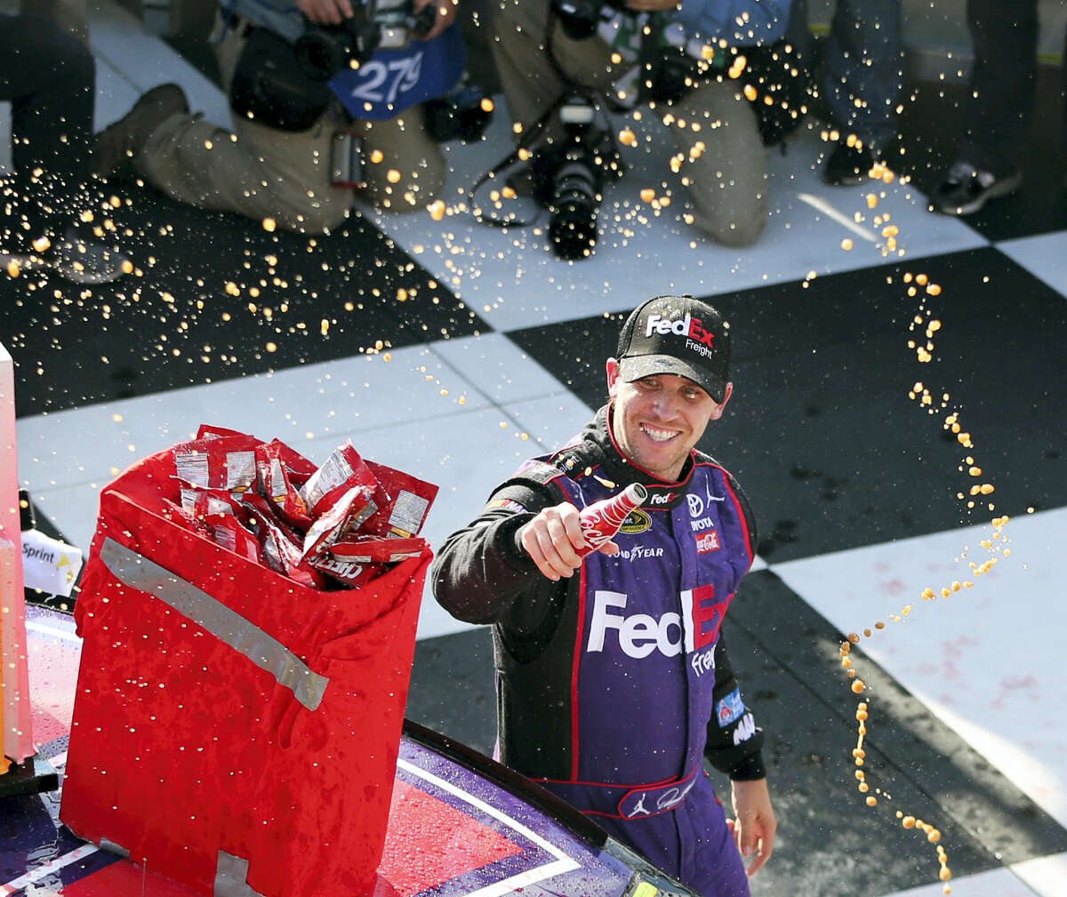 Denny Hamlin (11) celebrates in victory lane after winning this past Sunday.