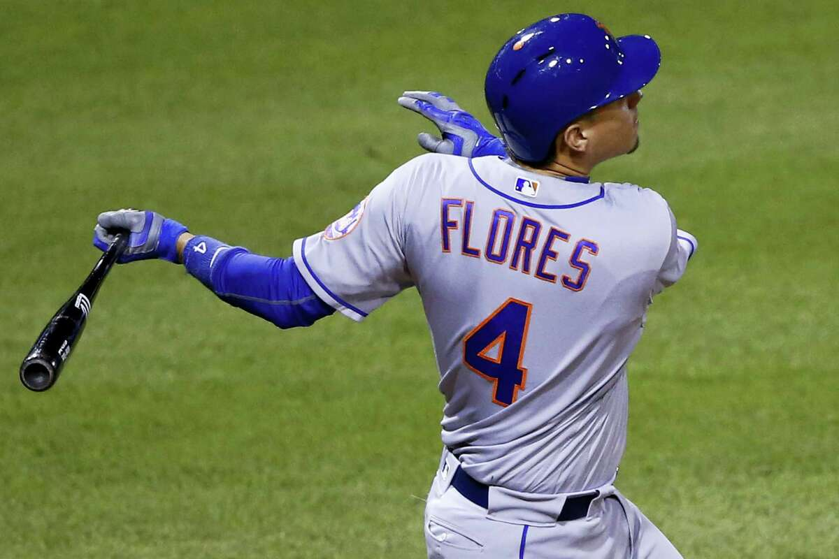 New York Mets' Wilmer Flores drives in a run with a single off Pittsburgh Pirates relief pitcher Cory Luebke during the 10th inning against the Pittsburgh Pirates in Pittsburgh, Wednesday. The Mets won 6-5.
