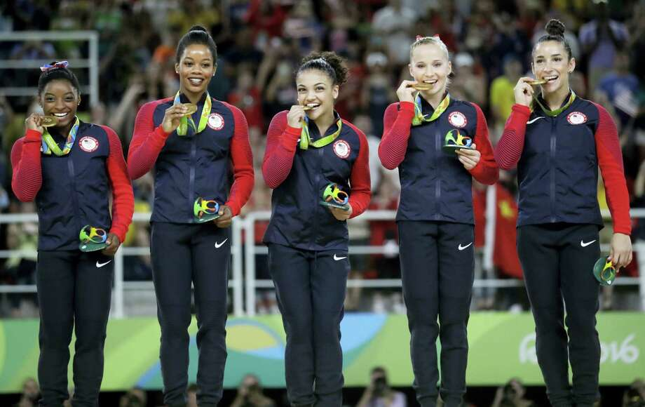 From left, U.S. gymnasts Simone Biles, Gabrielle Douglas, Lauren Hernandez, Madison Kocian and Aly Raisman hold their gold medals during the medal ceremony on Tuesday. Photo: Julio Cortez — The Associated Press  / Copyright 2016 The Associated Press. All rights reserved. This material may not be published, broadcast, rewritten or redistribu