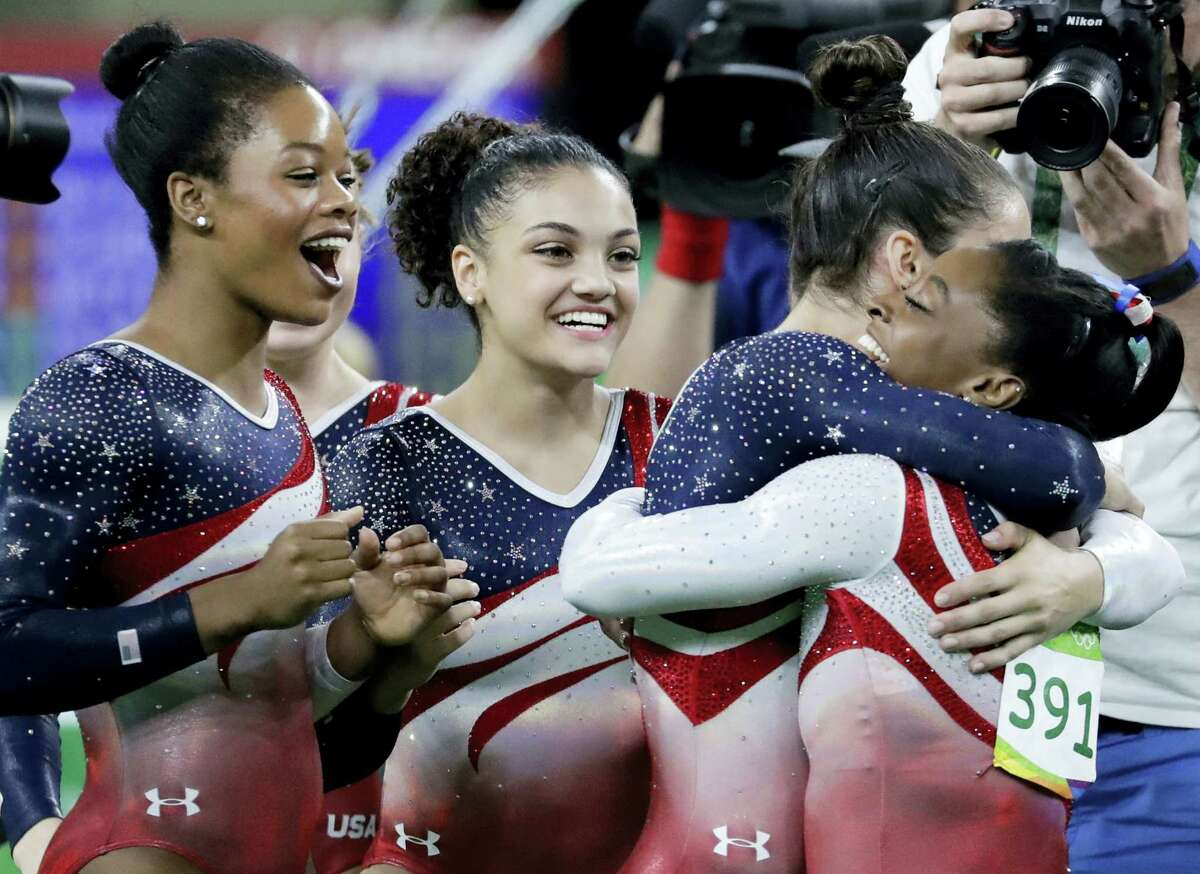 From left, Gabrielle Douglas, Lauren Hernandez, Aly Raisman and Simone Biles celebrate at the end of Tuesday's competition.