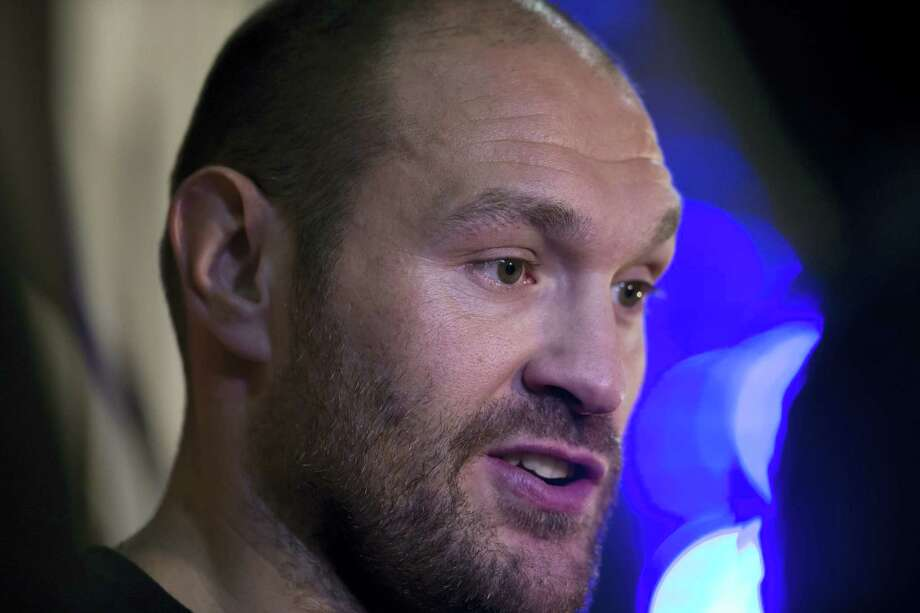In this April 27, 2016 photo, Britain's Tyson Fury, the heavyweight world boxing champion, is interviewed after attending a press conference in Manchester, England. Fury has vacated his WBO and WBA world titles to concentrate on his treatment and recovery from drug use and other personal issues. Fury's promotors released a statement early Thursday, Oct. 13, 2016 confirming the decision. Photo: AP Photo/Jon Super, File  / Copyright 2016 The Associated Press. All rights reserved. This material may not be published, broadcast, rewritten or redistribu
