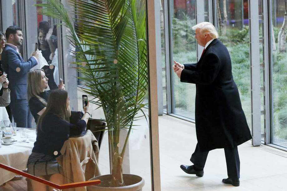 President-elect Donald Trump gestures to people seated in a restaurant as he leaves the New York Times building following a meeting Nov. 22 in New York. Photo: AP Photo — Mark Lennihan   / Copyright 2016 The Associated Press. All rights reserved.