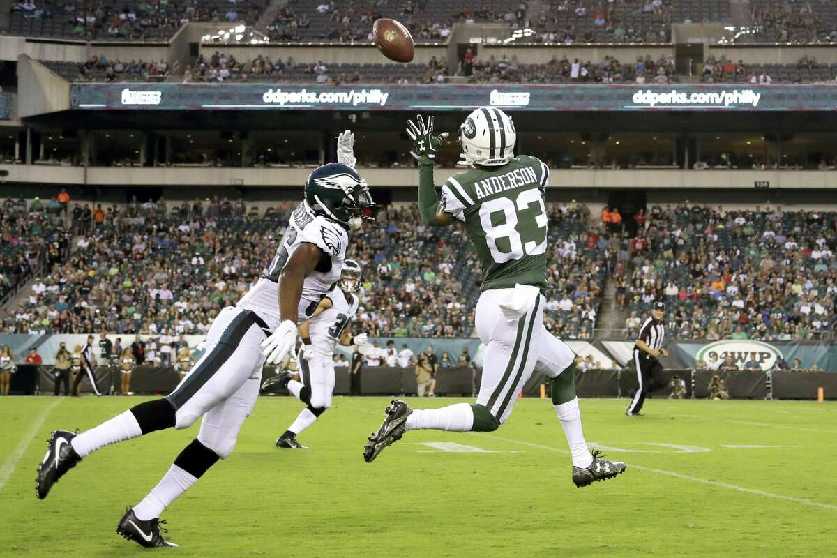 The Jets' Robby Anderson (83) pulls in a pass for an eventual touchdown against Philadelphia Eagles' JaCorey Shepherd, left, during a preseason game.