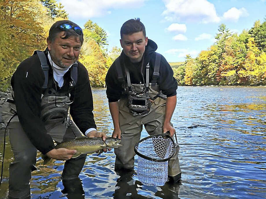 An unidentifed pair of anglers submitted this photo to the CTDEEP Angler's Guide Photo Contest Submission in 2015. Winning images have graced the cover of the Angler's Guide for three years. Photo: Courtesy Connecticut DEEP