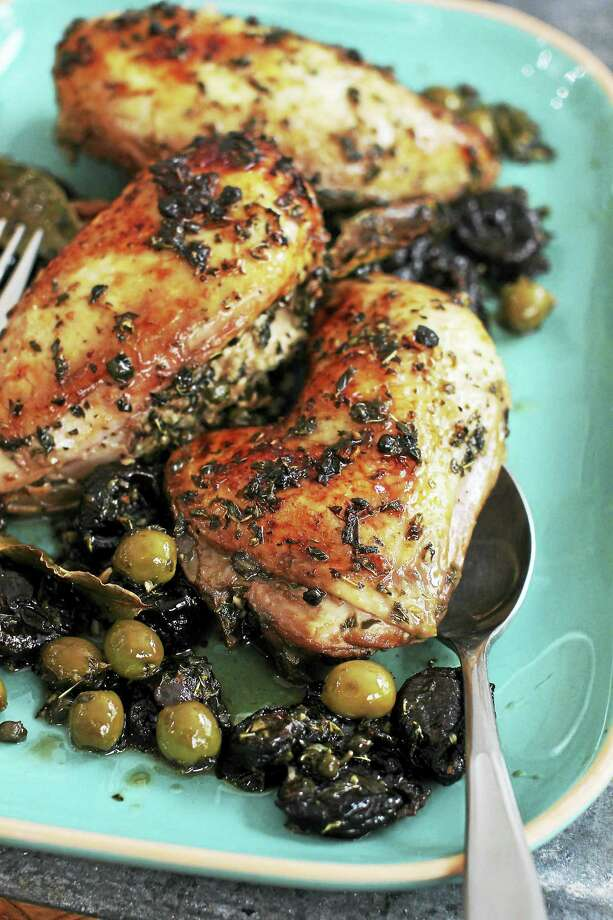 This classic recipe is foolproof, produces chicken that is unfailingly moist, and can be made ahead. Photo: Matthew Mead — The Associated Press  / FR170582 AP