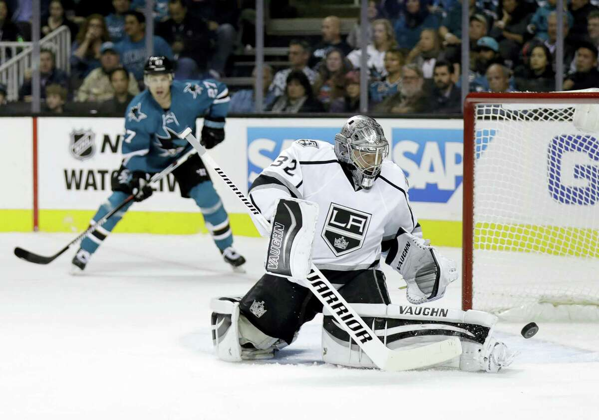 Kings goalie Jonathan Quick deflects a shot against the Sharks on Wednesday.