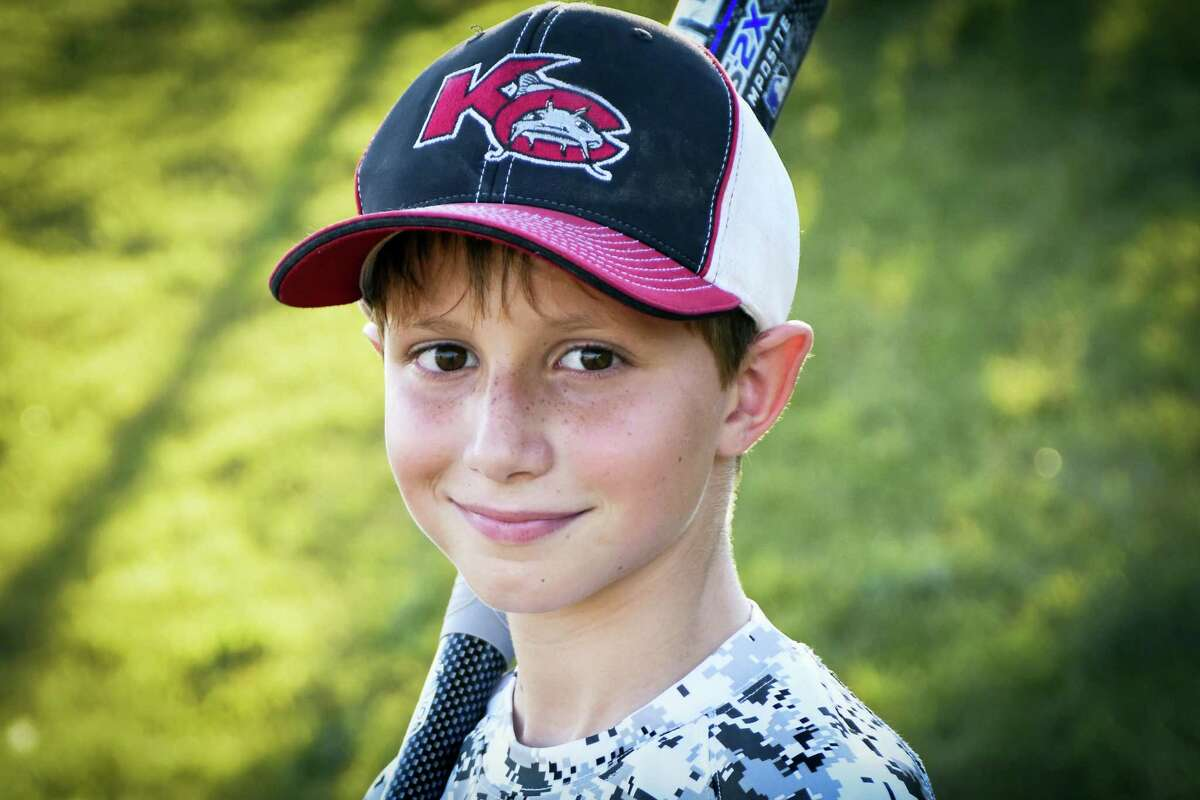 This June 2016 photo provided by David Strickland shows Caleb Thomas Schwab, the son of Scott Schwab, a Kansas state lawmaker from Olathe. Caleb died Sunday, Aug. 7, 2016 while riding the Verruckt, a water slide that's billed as the world's largest, at the Schlitterbahn Waterpark in Kansas City, Kan.