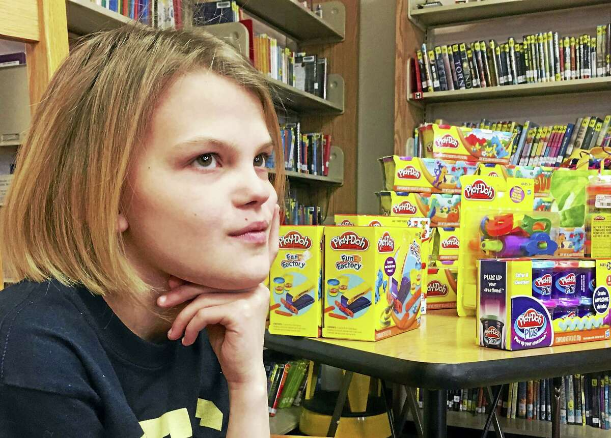 10-year-old Emma Becker, who was diagnosed with neurofibromatosis two years ago, is helping other Connecticut Children's Medical Center oncology patients get through their treatments by collecting containers of Play-Doh. She has collected more than 9,000 containers of Play-Doh, which helps distract patients during their treatments.