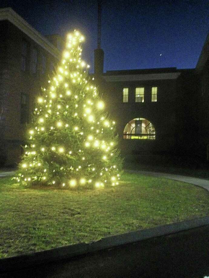 Now lit up, Cromwell's holiday tree gives off a welcoming glow for the Christmas season. Photo: Jeff Mill — The Middletown Press