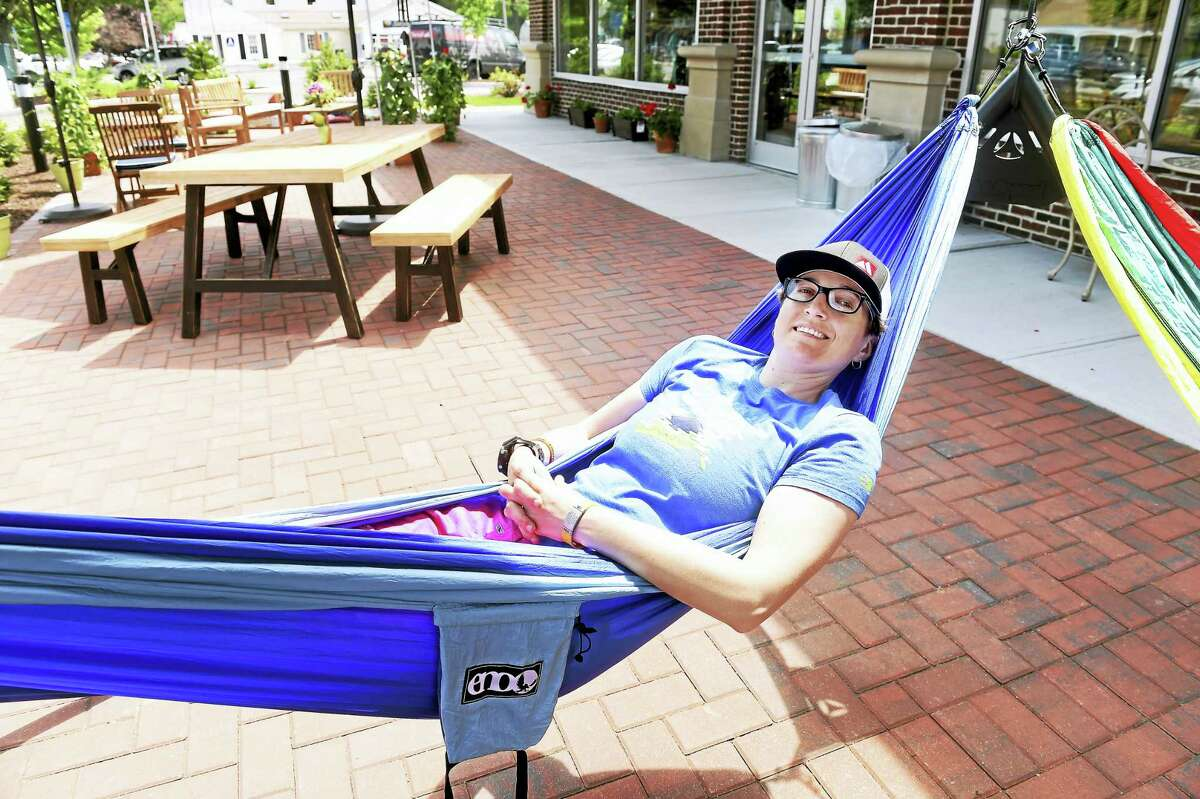 Amy Parulis, community relations and events manager, takes a time out in a hammock in front of the newly opened Denali on Main Street in Old Saybrook.