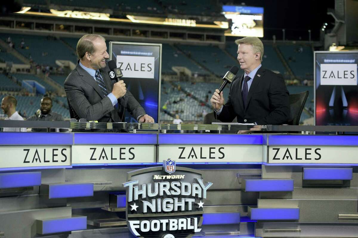 Thursday Night Football sportscasters Bill Cowher, left, and Phil Simms broadcast from the set during last season.